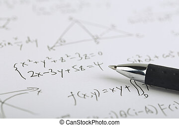 Math Concept - Closeup shot of complex math formulas on...