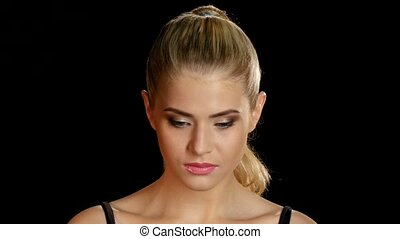 Bright makeup. Blonde model. Make-up. Black. Closeup -...