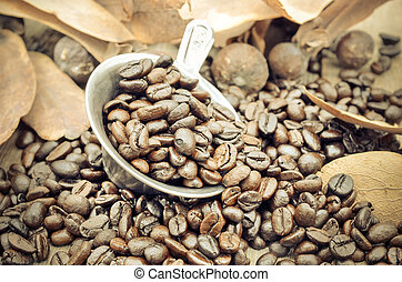 coffee beans on wooden background - Close up and selective...