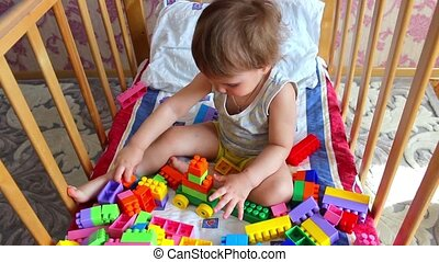Child playing with colorful plastic blocks. - Kids playing...