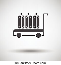 Luggage cart icon on gray background with round shadow....