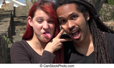 Female Redhead And African Man Acting Silly