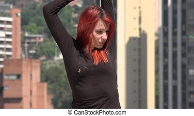 Young Redhead Woman Stretching