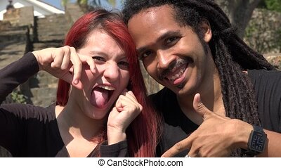 Happy Female Redhead Teen And African Man Posing