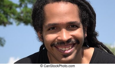 African Man With Mustache Smiling