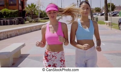 Happy healthy women enjoying a morning jog - Happy healthy...