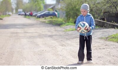 Boy playing football. Kid gamed soccer