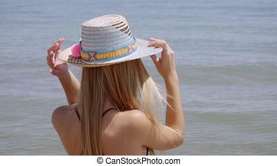Gorgeous young blond woman in a sunhat