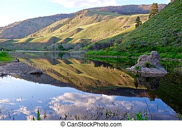 Reflection of Hills in Water. - Pipe Stone Canyon, North...