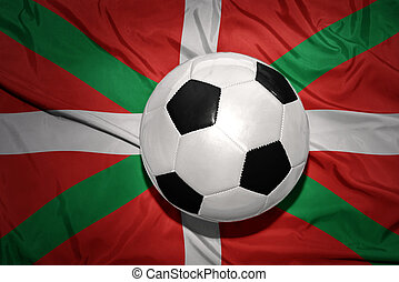 black and white football ball on the national flag of basque...
