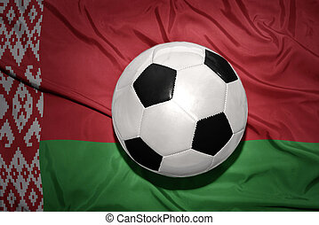 black and white football ball on the national flag of belarus