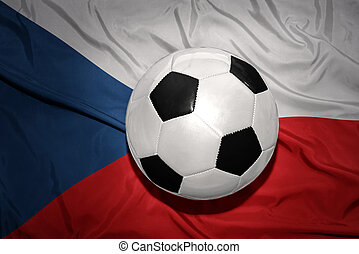 black and white football ball on the national flag of czech...