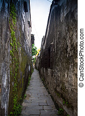Looking down an empty inner city alleyway - Looking down an...
