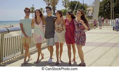 Young group of trendy friends on summer vacation together...