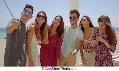 Group of young friends on vacation taking a selfie