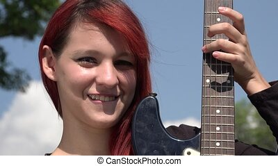 Confused Teen Redheaded Female With Guitar