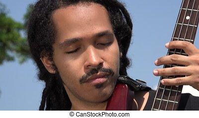 African Male Bass Guitarist