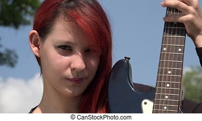 Redheaded Woman Posing With Guitar