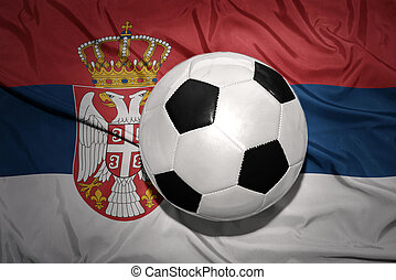black and white football ball on the national flag of serbia...