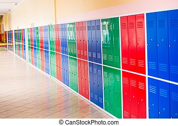 Colorful metal lockers installed in the hallway of the...
