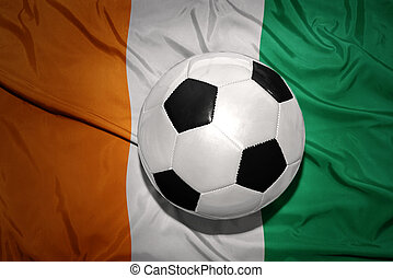 black and white football ball on the national flag of cote...