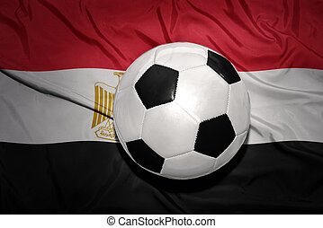 black and white football ball on the national flag of egypt...