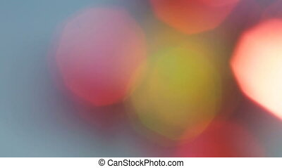 Colorful bokeh lights moving on a blue background.
