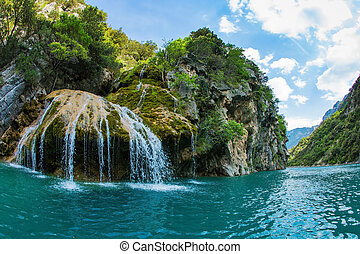The azure waterfall on canyon Verdon - Provence, France The...