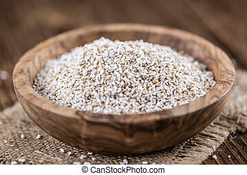 Portion of puffed Amaranth selective focus - Old wooden...