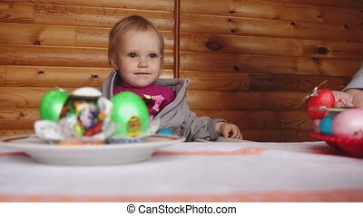 Easter breakfast with painted eggs - The little girl and her...