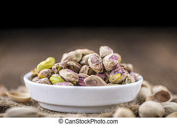 Pistachio Kernels as detailed close-up shot selective focus...