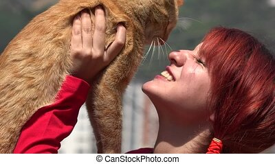Redheaded Teen Playing With Cat