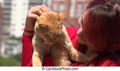 Redheaded Young Woman And Cat