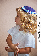The charming boy with blue eyes in knitted yarmulke - The...