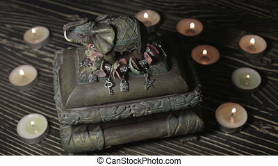 A figurine of an elephant by candlelight - Bag with an...