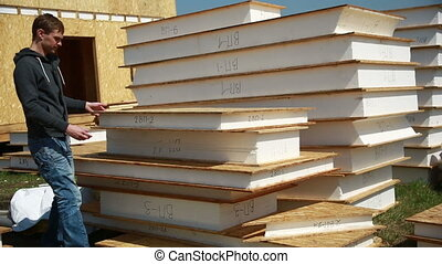 a man building a house foam polystyrene blocks made of...