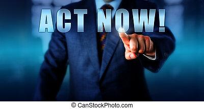 Entrepreneur Pushing ACT NOW! - Male entrepreneur is pushing...