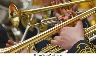 Musician playing the trumpet, closeup - Hands close-up...