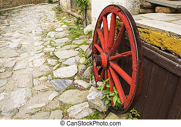 Old Wooden Red Wagon Wheel - Old wooden red wagon wheel on...