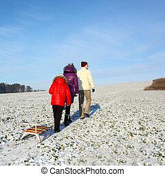 Family walking in winter. Family take a walk on winter