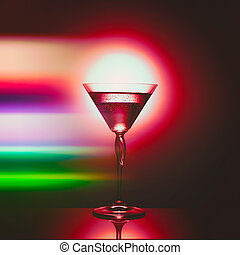 A glass on rainbow background with alcohol with bubbles with reflection.