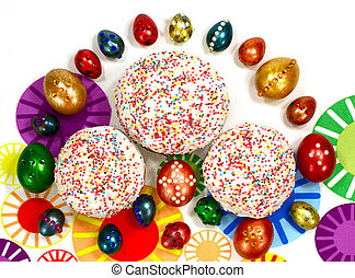 Traditional Easter cake and colored eggs with ornaments on...