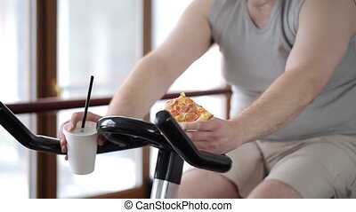 Fat guy with a piece of pizza in his hand lazily spinning...