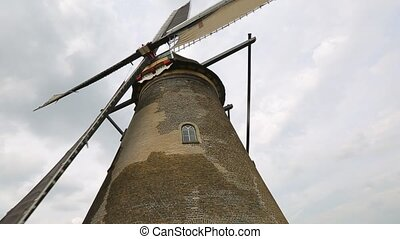 Windmill from below - Old windmill spinning in the wind