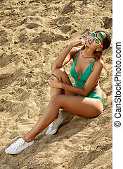 sunbathe - Attractive sexy tanned girl on the beach. Summer...