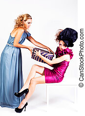 Two Young Women Fight Over a Hat Box