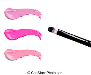 lipstick stroke (sample) with makeup brush, isolated on white