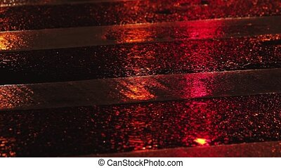 Rainy night in the city. Reflection of traffic lights...