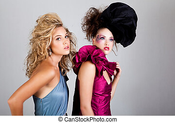 Two Young Women in Avant Garde Attire - Two young women...