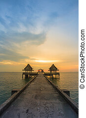 Walkway leading to the sea, beautiful sky during sunset,...